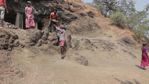 Indian farmers carry the stones on their heads Footage