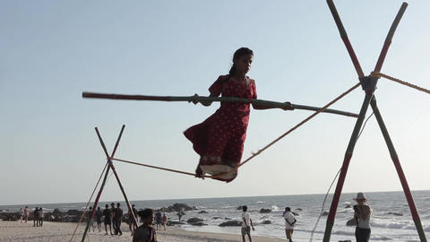 Indian tightrope walker on the beach Footage