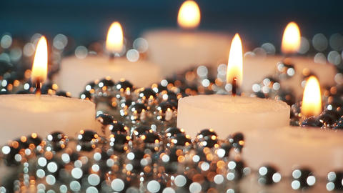 burning candles and christmas beads loopable Footage