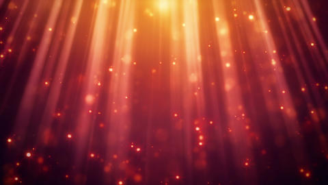 festive glitter particles in light rays loopable background Animation
