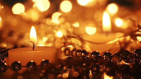 close-up burning candle and christmas lights seamless loop Footage
