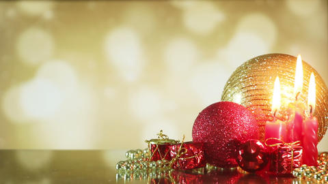 christmas balls and candle on shiny background seamless loop Footage