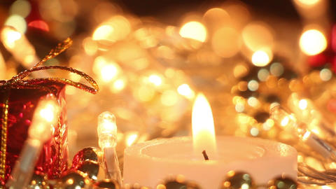 candle and christmas lights close-up out of focus Footage