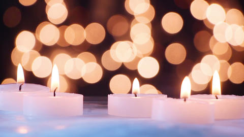 burning candles and bokeh light seamless loop Footage