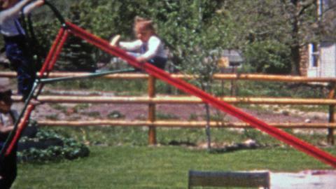 1952: Toddler sliding backwards down steep residential home slide Live Action