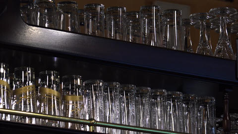 Glasses and cups on a shelf in the restaurant. 4K Footage