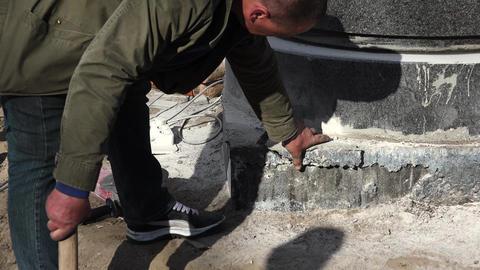 Sledge hammer blows of granite stones. 4K Footage