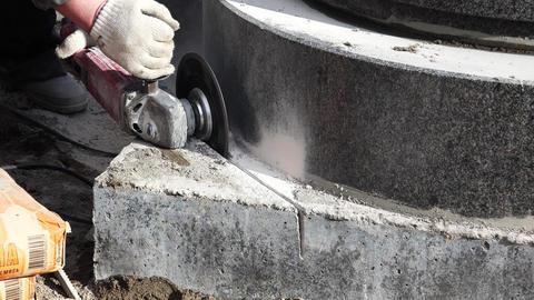 Mason grinder granite sawing. 4K Footage