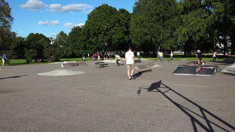 Skateboarding. Young people riding on site. 4K Footage