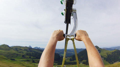 Woman Ziplining Down A Mountain stock footage
