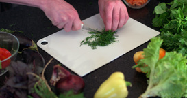 Cutting Of Dill In The Kitchen stock footage