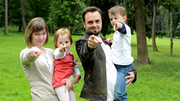 Family (middle Couple In Love, Cute Girl And Small Boy) Together Point To Camera stock footage
