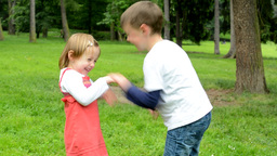 children (siblings - little boy and cute girl) playing in the park (siblings tic Footage