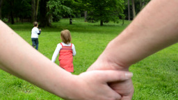 family - man and woman holding hands - detail - children (siblings - little boy  Footage