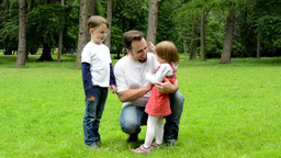 Middle Aged Father Plays With Children (boy And Girl) - Park stock footage