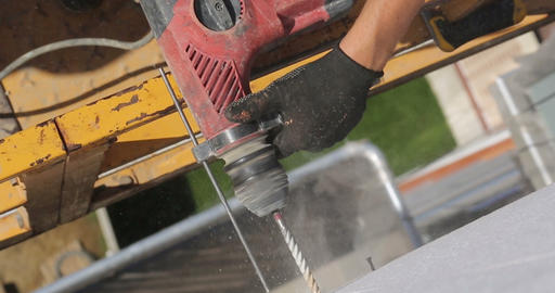 Construction. Man drills wall with perforator Footage