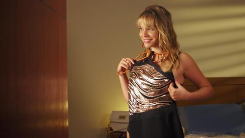 1 Beautiful Woman Choosing Elegant Dress For Date stock footage