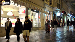 night city - urban street (pavement) with walking people - stores Footage