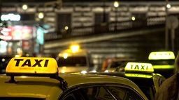 Sign On The Car - Taxi - Night - Urban Street In The City With Cars And People stock footage