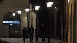 night urban street with people - lamps in row - night exterior building Footage