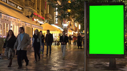 billboard in the city - urban street with buildings - green screen - people Footage