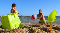 Father And Son Playing Ball On The Beach stock footage