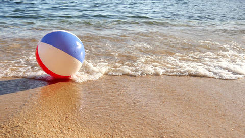 Beach Ball at the Mercy of the Waves Footage