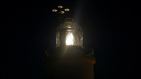 Maritime Lighthouse Flashing and Spinning at Night Footage