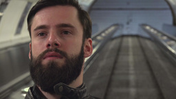young handsome hipster man travels on the escalator in the subway Footage