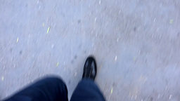man walks on sidewalk - closeup legs Footage