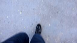man walks on sidewalk - closeup legs Live Action