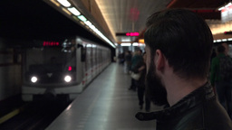 young handsome hipster man waits for subway and looks around - arriving metro Footage