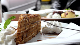 food - desserts - honey cake and sand cake in background - detail Footage