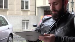 young handsome hipster man works (typing) on smartphone - restaurant: outdoor se Footage