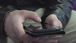 Man Works (typing) On Smartphone - Interior - Closeup stock footage