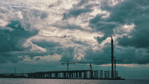 Dramatic Clouds over a Bridge Under Construction, timelapse Footage