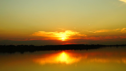 Sunset On The Lake With Water Reflection and flying bird Footage