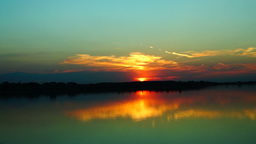 Beautiful sunset with clouds mirror in water Footage