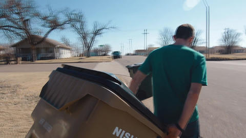 Man Taking Trash Can To Street Live Action
