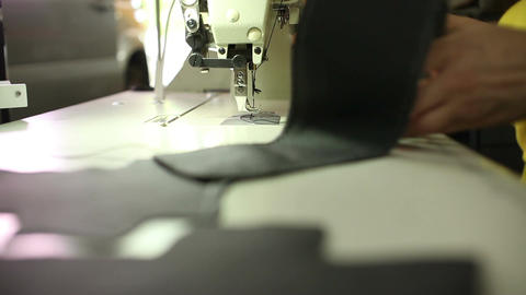 Car service station: a leather stitching on a sewing machine Footage