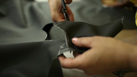 Car service station: the scissors are cut the leather for the pattern Footage