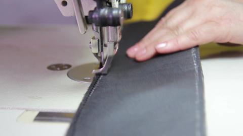 Car service station: a leather stitching on a sewing machine Live Action