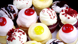 Delicious lemon, cherry and chocolate cupcakes Footage