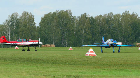 YAK-52 sport planes preparing for take-off Footage