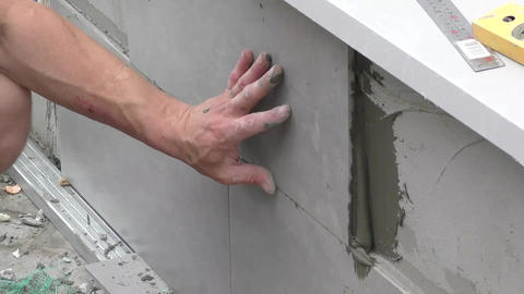Man works with facing tiles Footage