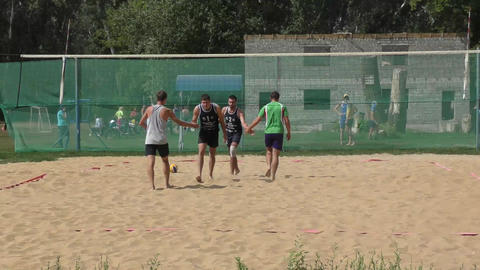 Men play beach volleyball Footage