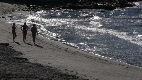 people walking along the beach Footage