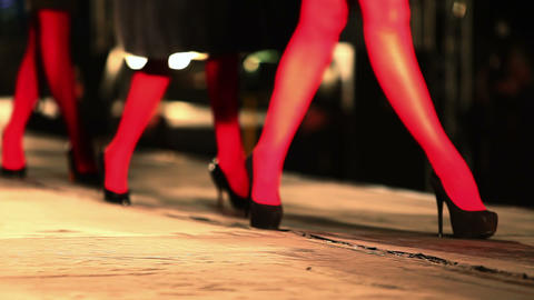 Model walks the runway, black shoes close-up in fashion house Live Action