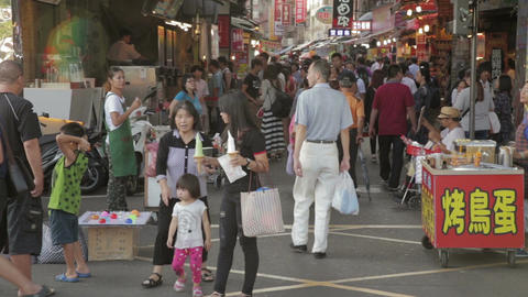 Shoppers walking through Danshui market entrance Footage