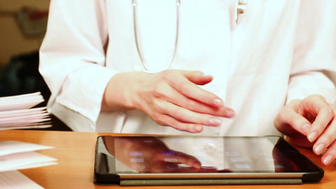 Doctor Working On Tablet Computer stock footage